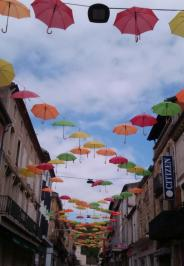 Umbrella display in Fumel, France
